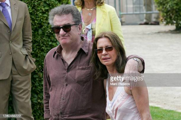 June 18: Actor and singer Eddy Mitchell and wife Muriel Bailleul arrive at the Sainte-Eugenie church ahead Jade Hallyday's baptism on June 18, 2005...