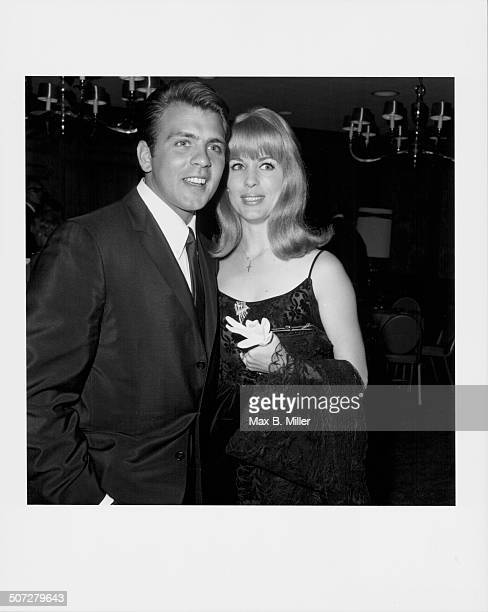 Actor and singer Fabian Forte with his fiancee Katy Regan attending the Nancy Ames opening at Century Plaza Los Angeles CA 1966
