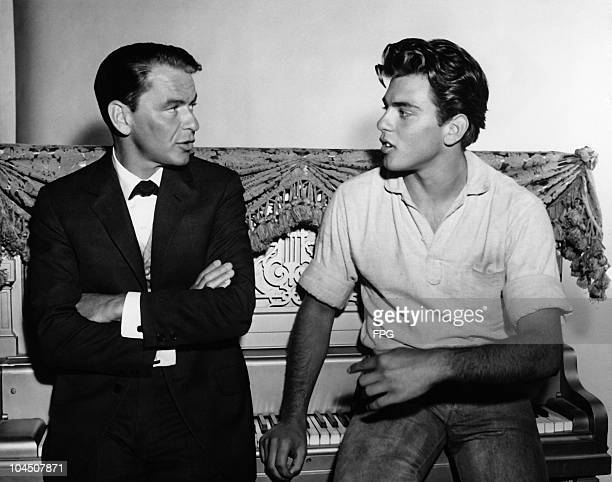 Actor and singer Frank Sinatra talking to actor Fabian Forte on the set of the production 'Can Can' circa 1960