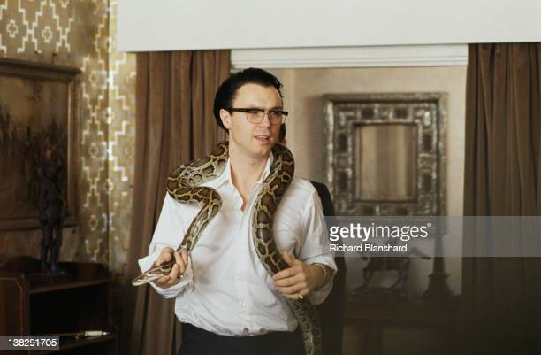 Actor and singer Gary Kemp as Ronnie Kray with a python in a scene from the biopic film 'The Krays' 1990