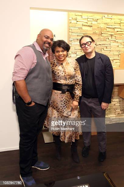 Actor and singer James Monroe Iglehart author and journalist April Ryan and a guest pose at Lafayette 148 New York x April Ryan Under Fire Book...