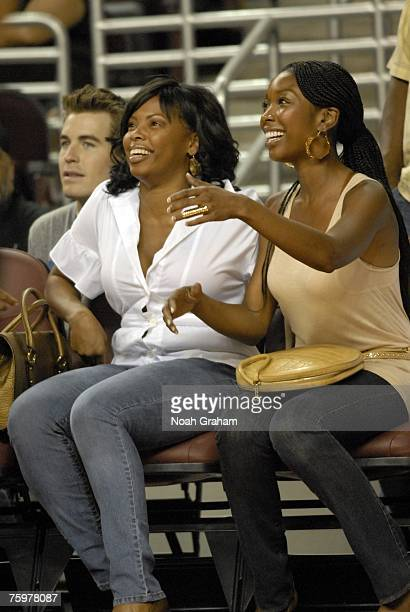 Actor and singer Jennifer Hudson sits with actor and singer Brandy as celebrities play in the LA Stars Celebrity AllStar Game at the USC Galen Center...