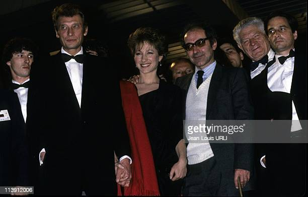 Actor and singer Johnny Halliday actress Nathalie Baye and director JeanLuc Godard attend the official presentation of the film 'Detective' at Cannes...