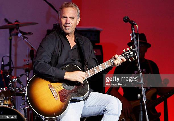 Actor and singer Kevin Costner performs on stage with his band Modern West during the Mc Donalds Fundraising Gala at Hyatt Hotel on October 17, 2009...