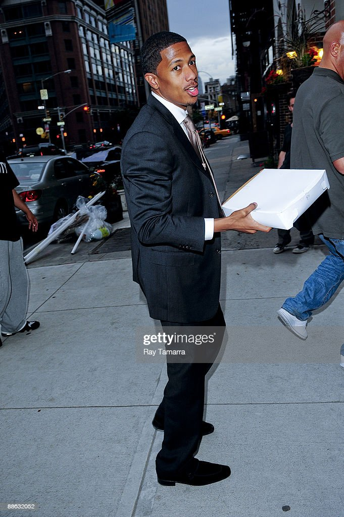 Actor and singer Nick Cannon returns to his Tribeca home on June 22, 2009 in New York City.