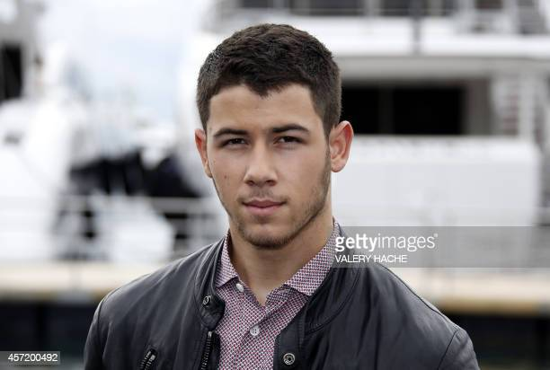 US actor and singer Nick Jonas poses during a photocall for the TV serie Kingdom as part of the MIPCOM on October 14 2014 in Cannes southeastern...