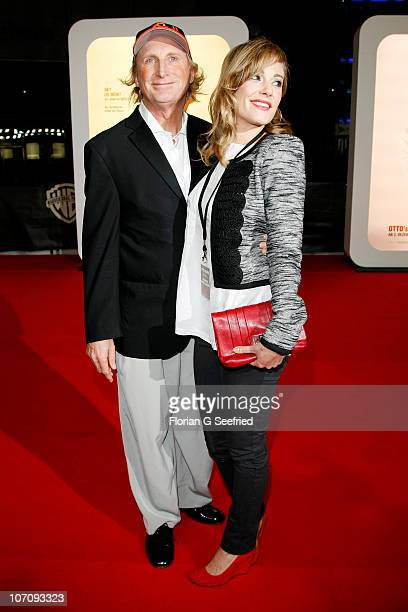 Actor and singer Otto Waalkes and wife actress Eva Hassmann attend the premiere of 'Otto's Eleven' at CineStar at Sony Center on November 23, 2010 in...