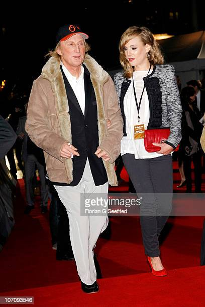 Actor and singer Otto Waalkes and wife actress Eva Hassmann attend the premiere of 'Otto's Eleven' at CineStar at Sony Center on November 23 2010 in...