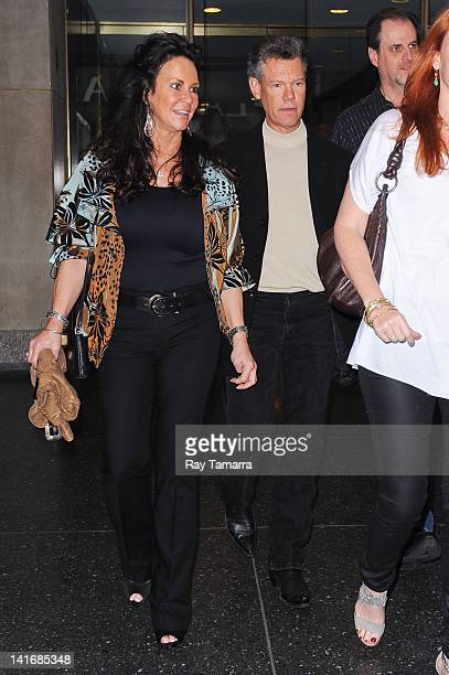 Actor and singer Randy Travis and Mary Beougher leave the Good Morning America taping at the ABC Times Square Studios on March 21 2012 in New York...