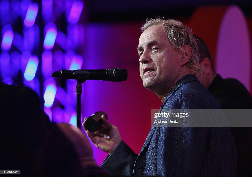 Actor and singer Uwe Ochsenknecht performs on stage during the 'Deutscher Hoerfilmpreis 2011' at the Atrium Deutsche Bank on March 15, 2011 in Berlin, Germany.