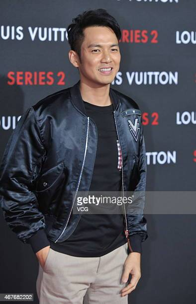 Actor and singer Wallace Chung attends the opening event of LV 'Series 2' at China World Shopping Mall on March 26 2015 in Beijing China