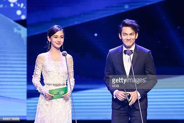 Actor and singer Wallace Chung from Hong Kong and actress and model Angelababy from Hong Kong attend the award closing ceremony of 22nd Shanghai TV...