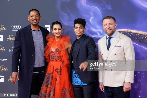 US actor and singer Will Smith British actress and singer Naomi Scott Canadian actor Mena Massoud and British director Guy Ritchie attend the movie...