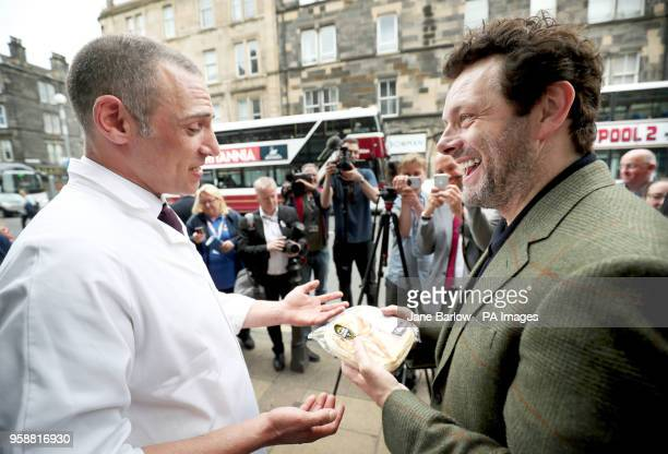 Actor and social campaigner Michael Sheen receives a steak pie from Daniel Currie from Anderson Butchers during the opening of the new Castle...