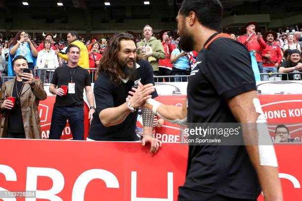 Actor and star of the movie Aquaman Jason Mamoa greets the New Zealand All Black Sevens during day 2 of the 2019 Canada Sevens Rugby Tournament on...
