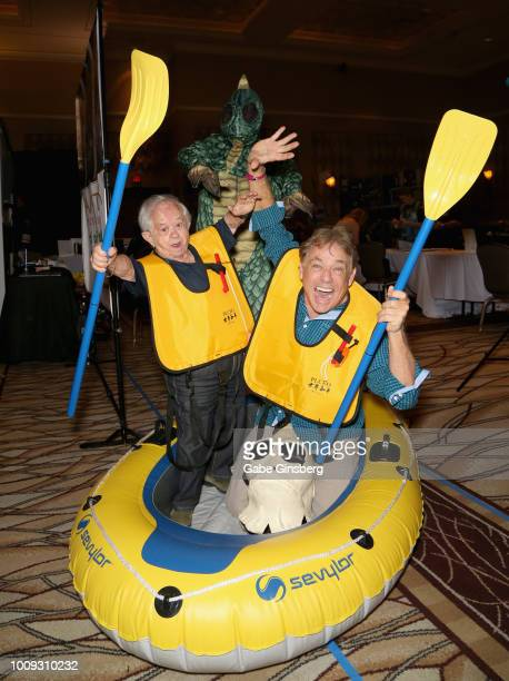 Actor and stuntman Felix Silla Richard Brown dressed as the character S'latch from the Land of the Lost television series and actor Wesley Eure joke...