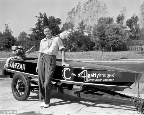 Actor and swimmer Johnny Weissmuller poses with a speedboat named for his most famous screen role that of Edgar Rice Burroughs' Tarzan circa 1935