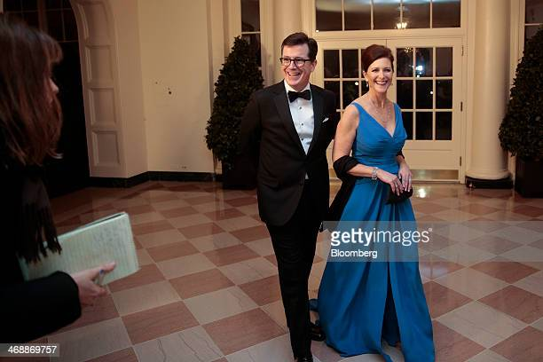 Actor and television host Stephen Colbert left and his wife Evelyn Evie Colbert arrive at a state dinner hosted by US President Barack Obama and US...