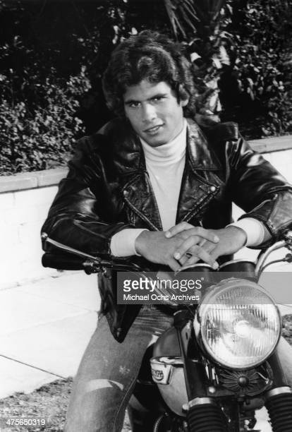 Actor and TV personality Lorenzo Lamas poses for a portrait on his Triumph motorcycle in 1980 in Los Angeles California