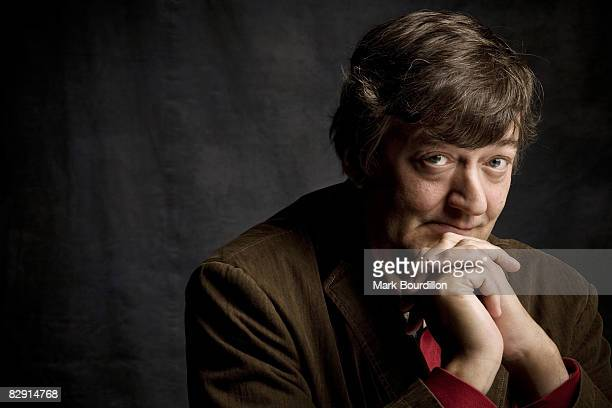 Actor and tv presenter Stephen Fry poses for a portrait shoot for the Sunday Times newspaper in London on September 7, 2007.