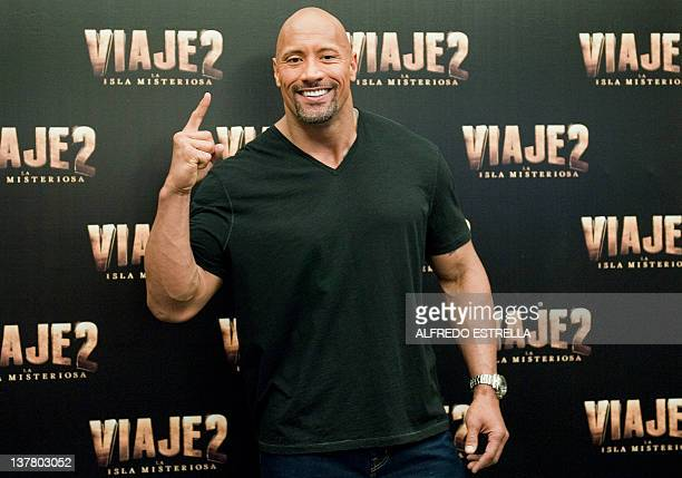US actor and wrestler Dwayne Johnson aka The Rock poses for photographers before a press conference to present 'Journey 2 The Mysterious Island'...