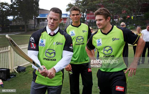SYDNEY NSW Actor and wrestler John Cena is given tips by cricketers Chris Green and Shane Watson during a Sydney Thunder media call at the Sydney...