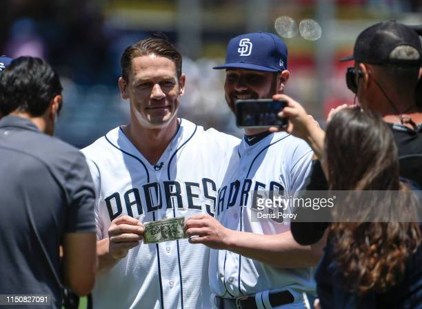 Actor and wrestler John Cena left presents Logan Allen of the San Diego Padres with a dollar to pay a bet that Cena lost before a baseball game...
