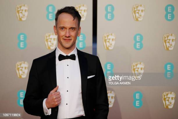 US actor and writer Jeff Whitty poses on the red carpet upon arrival at the BAFTA British Academy Film Awards at the Royal Albert Hall in London on...