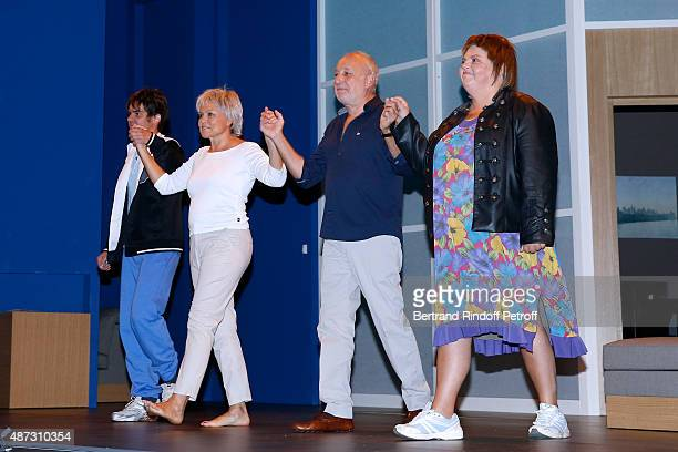 Actor and Writer Sebastien Thiery, Actors Muriel Robin, Francois Berleand and Ninie Lavallee acknowledge the applause of the audience at the end of...