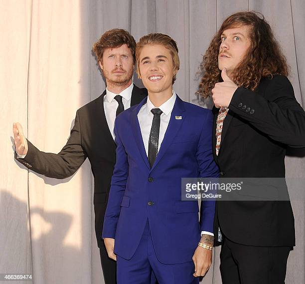 Actor Anders Holm honoree Justin Bieber and actor Blake Anderson arrive at the Comedy Central Roast of Justin Bieber on March 14 2015 in Los Angeles...