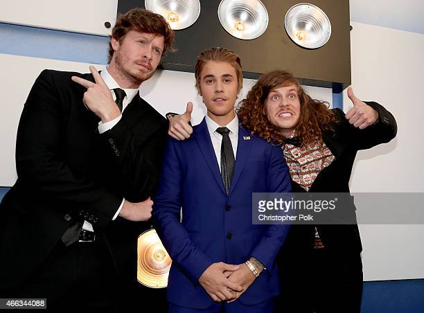 Actor Anders Holm honoree Justin Bieber and actor Blake Anderson attend The Comedy Central Roast of Justin Bieber at Sony Pictures Studios on March...