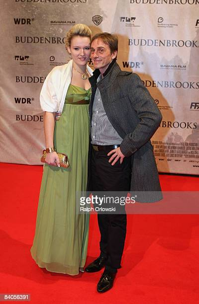 Actor Andre Hennicke and his girlfriend Denise Gebhardt arrive for the Buddenbrooks premiere at the Lichtburg cinema on December 16 2008 in Essen...
