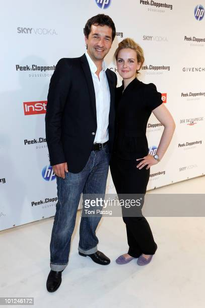 Actor Andreas Elsholz and girlfriend Denise Zich attend the 'Sex And The City 2' movie night at the Peek Cloppenburg flagship store on May 28 2010 in...