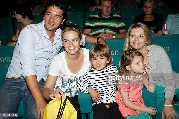 Actor Andreas Elsholz and wife actress Denise Zich son Julius and Faye Montana and actress AnneSophie Briest attend the Berlin premiere of Mullewapp...
