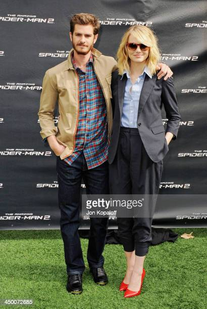 """Actor Andrew Garfield and actress Emma Stone pose at """"The Amazing Spiderman 2"""" - Los Angeles Photo Call at Sony Pictures Studios on November 16, 2013..."""