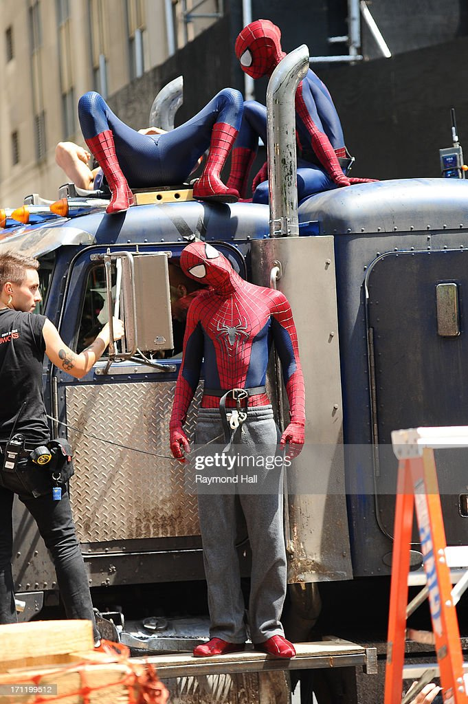 Actor Andrew Garfield (C), his stunt double William Spencer (R) and a second stunt double are seen on set of 'The Amazing Spider-Man 2' on June 22, 2013 in New York City.