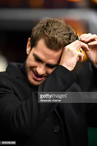 Actor Andrew Garfield is seen cutting of a piece of hair at the 'Breathe' premiere at the 13th Zurich Film Festival on October 6 2017 in Zurich...