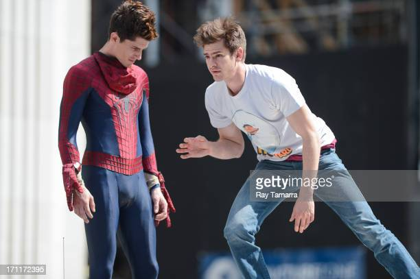 Actor Andrew Garfield rehearses a scene with his stunt double William Spencer at the The Amazing Spiderman 2 movie set in Madison Square Park on June...