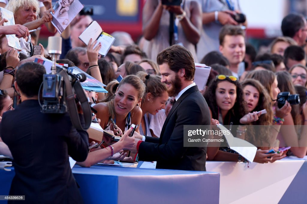 Actor Andrew Garfield signs autographs with fans at the '99 Homes' premiere during the 71st Venice Film Festival on August 29, 2014 in Venice, Italy.