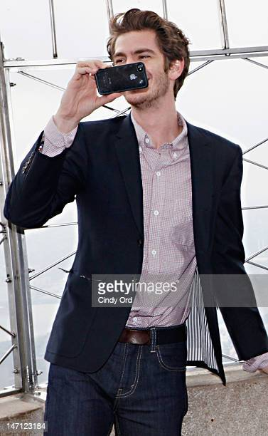 Actor Andrew Garfield takes pictures with his iphone on the observatory deck of The Empire State Building on June 25 2012 in New York City