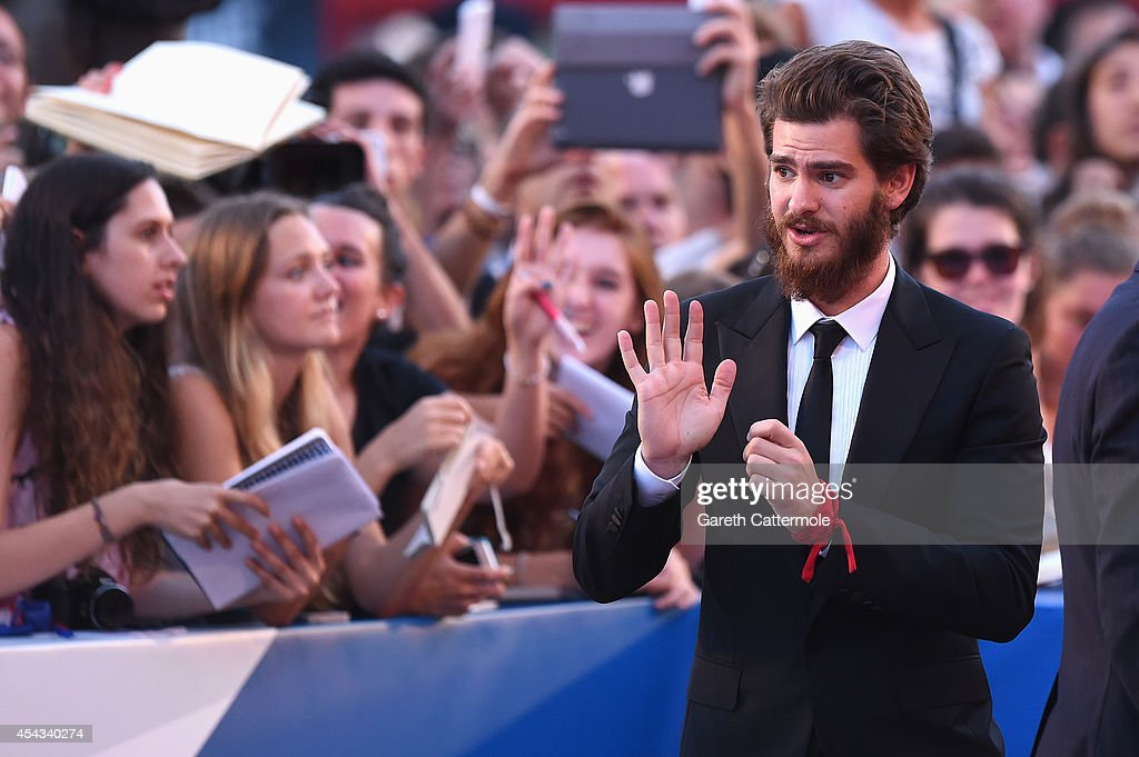 Actor Andrew Garfield waves at the '99 Homes' premiere during the 71st Venice Film Festival on August 29, 2014 in Venice, Italy.
