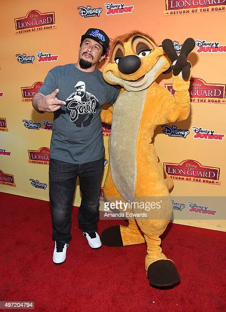 Actor Andrew Kishino and Timon arrive at the premiere of Disney Channel's 'The Lion Guard Return Of The Roar' at Walt Disney Studios on November 14...