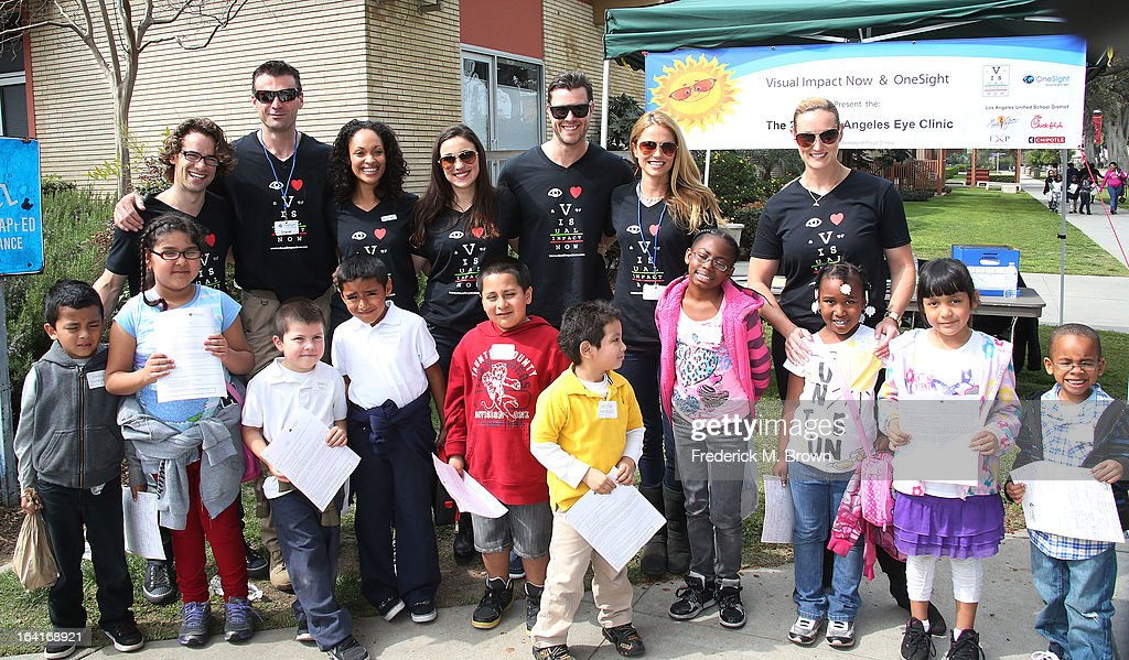 Actor Andrew Lees, Daniel Feuerriegel, Cynthia Addai-Robinson, Jenna Lind, Stephen Dunlevy, Ellen Hollman, and Vanessa Cater, of the cast of Starz 'Spartacus: War Of The Damned' lend support at the 2013 Visual Impact Now Annual Eye Clinic Event on March 20, 2013 in Los Angeles, California.