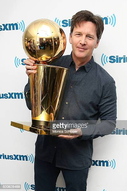 Actor Andrew McCarthy poses for a photo with the The Larry O'Brien NBA Championship Trophy when he visits SiriusXM Studio on April 12 2016 in New...