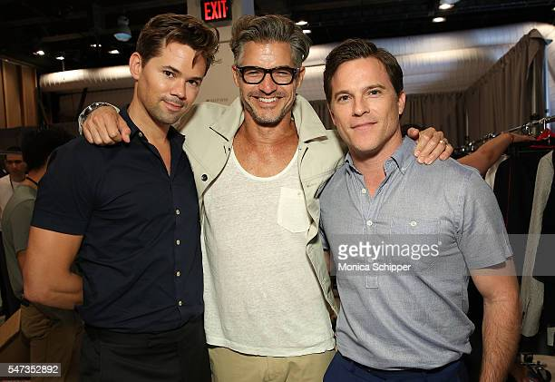 Actor Andrew Rannells model and CFDA ambassador for NYFWM Eric Rutherford and actor Michael Doyle pose for a photo backstage after the Todd Snyder...