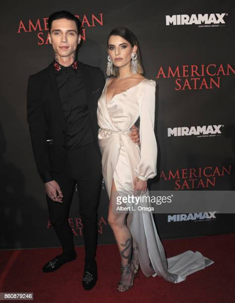 Actor Andy Biersack and singer Juliet Simms arrive for the Premiere Of Miramax's 'American Satan' held at AMC Universal City Walk on October 12 2017...