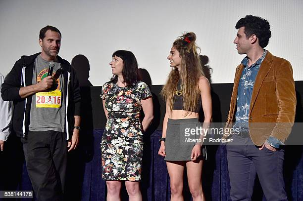 Actor Andy Buckley producer Laura Wagner director Alexi Pappas and director Jeremy Teicher speak onstage at the premiere of 'Tracktown' during the...