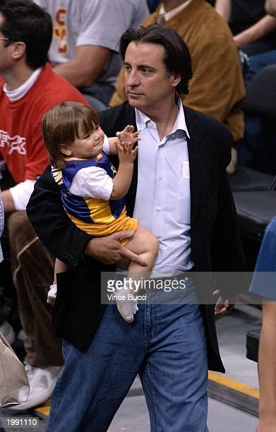 Actor Andy Garcia and his son Andres attend the Los Angeles Lakers v San Antonio Spurs playoff game at the Staples Center May 11 2003 in Los Angeles...