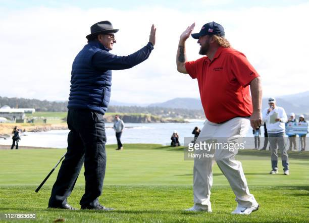 Actor Andy Garcia celebrates his chip with Colt Ford to give his team the win on the 18th hole during the 3M Celebrity Challenge at the ATT Pebble...