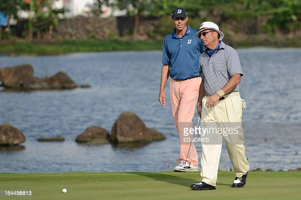 Actor Andy Garcia of the US and golfer Matt Kuchar of the US walk on the18th hole on the final day of the World Celebrity Pro-Am golf tournament at...